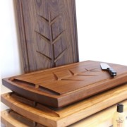 stack of carving boards in walnut, mahogany, cherry and maple