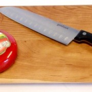 cherry cutting board with engraved logo on the front