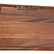family name engraved into a mahogany cutting board