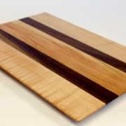 figured cherry cutting board with walnut accent