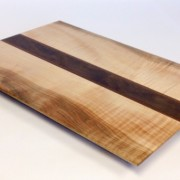 Figured maple cutting board with walnut accent