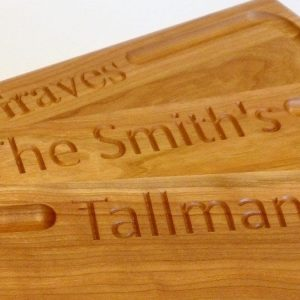 stack of three cherry Chefs board with personalized engraving and juice groove