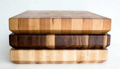 stack of end grain butcher blocks made of maple, walnut and cherry woods