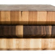 profile view of stack of butcher blocks of maple, walnut and cherry