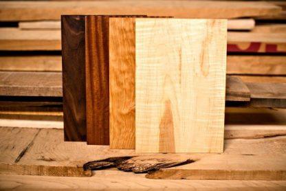 cheeseboard of walnut, cherry, mahogany and maple
