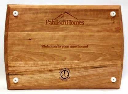 builders logo and message engraved in the back of a cherry cutting board