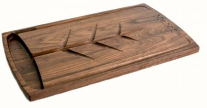 walnut carving board with juice well grooves and family name