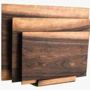 set of three walnut cutting boards in matching stand