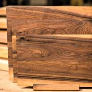 Trio of walnut cutting board with stand
