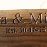 first names and date engraved into walnut cutting board
