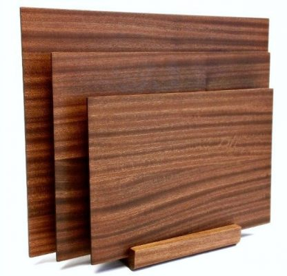 set of three mahogany cutting boards with stand