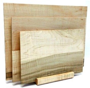 set of maple cutting boards with matching stand