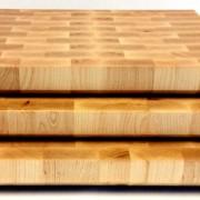 profile of a stack of three maple end grain butcher blocks