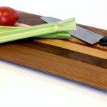 long cutting board with veggies on it