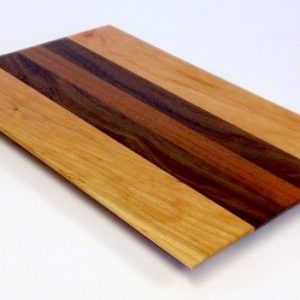 cherry cutting board with walnut and mahogany accents