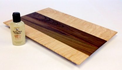 figured maple and walnut cutting board