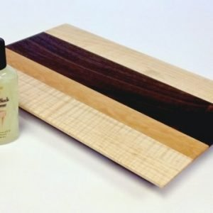 figured maple cutting board with walnut and cherry accents