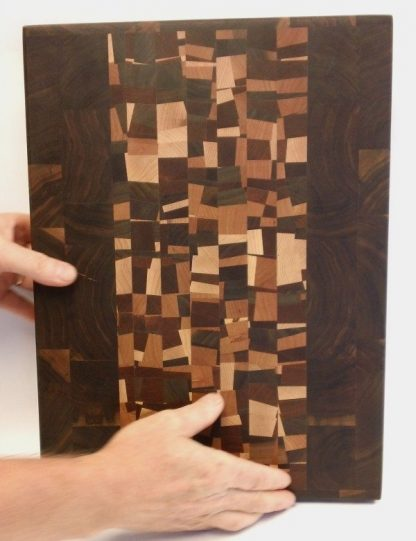 Walnut end grain butcher block with confetti accent, hands for scale