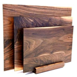 walnut set of three cutting boards in matching stand