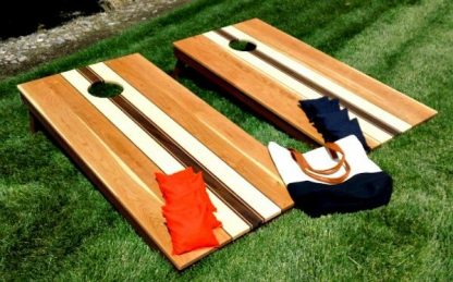 cherry corn hole set with maple and walnut center stripe