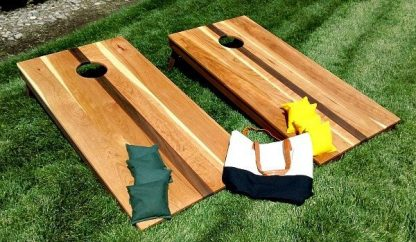 cherry, walnut and mahogany regulation corn hole set with bags and carry bag