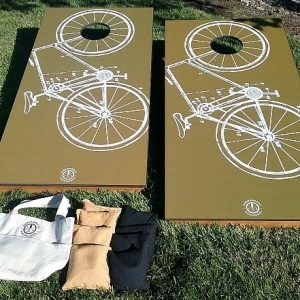 Bicycle graphic mustard background, corn hole game
