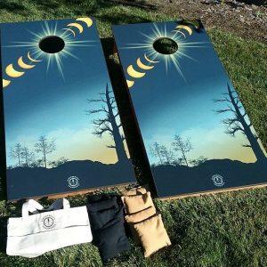 corn hole game, solar eclipse graphics