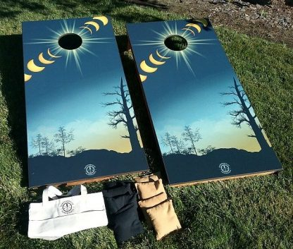 corn hole game, solar eclipse graphics