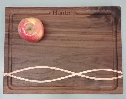 Impress clients with this personalized walnut cutting board